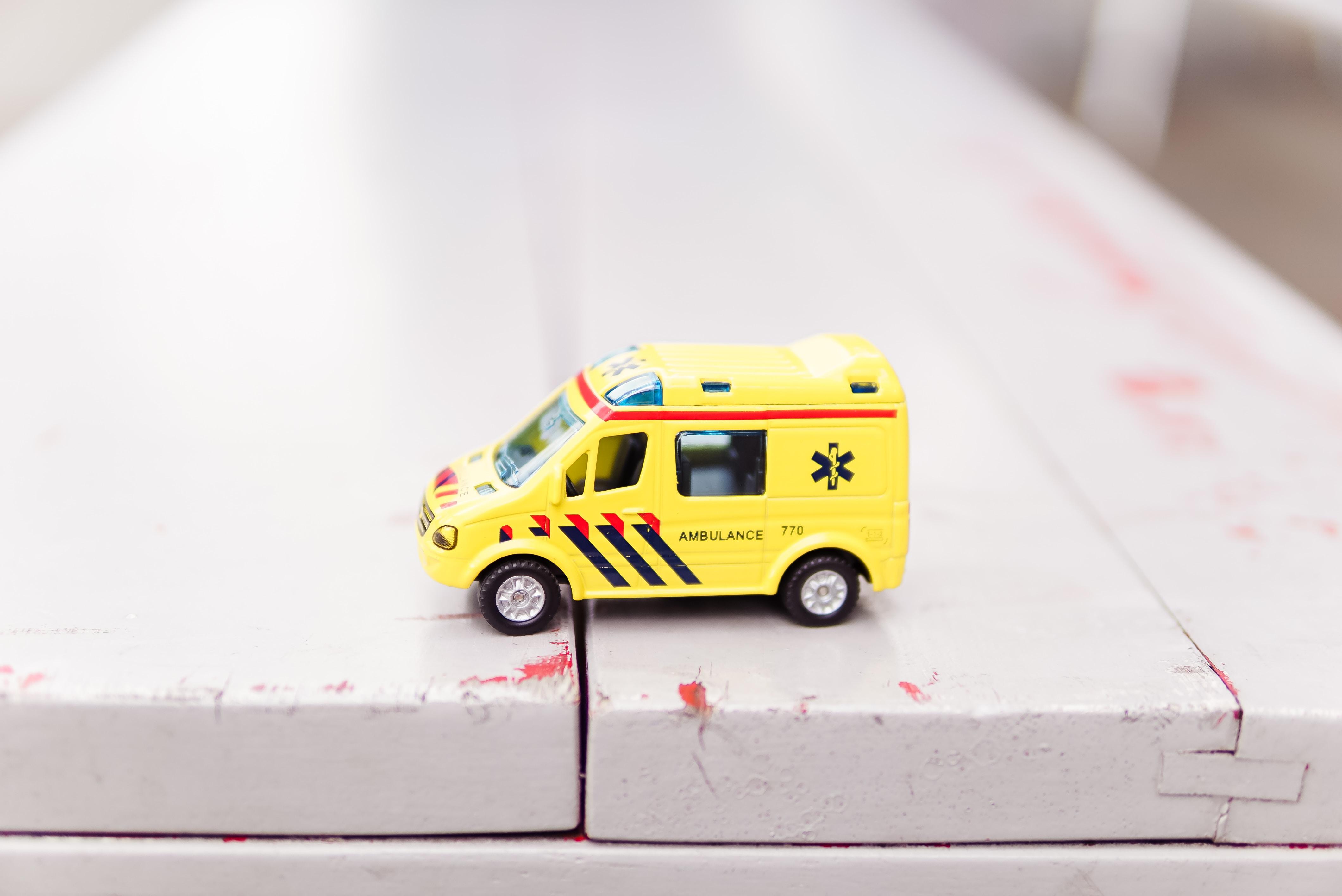 Ambulance toy on white surface