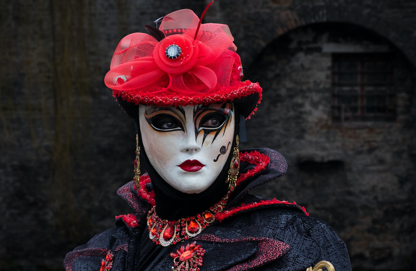 woman with a decorative mask on her face